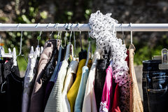 Second hand women's jackets on display at flea market Stock Image
