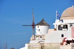 Windmill in Oia in the island of Santorini. Greece stock photography