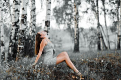 Second life. Beautiful woman on the background of a dying forest Royalty Free Stock Photo