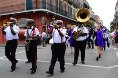Second Line March. A second line marches through the streets of the French Quarter in New Orleans Stock Photography