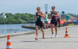 Second Raz Poradosu and third place Shira Katz competing at the women`s race during Dnipro ETU Triathlon Junior European Cup. DNIPRO, UKRAINE - June 03, 2018 royalty free stock image