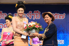 The Second Runner-Up for Miss Songkran 2014. Chiangrai, Thailand - April 13, 2014: The second runner-up is receiving award for Miss Songkran Beauty Contest 2014 Royalty Free Stock Photos