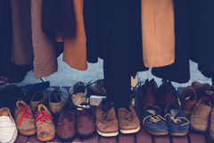 Second shoes. Many collection second hand vintage fashion shoes below the cloth rack Royalty Free Stock Image