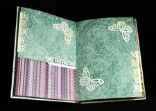 Second spread of a small handmade photoalbum stock image
