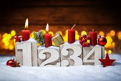 Second sunday in advent concept. Xmas light wooden background with candles ball bauble stars Stock Photos
