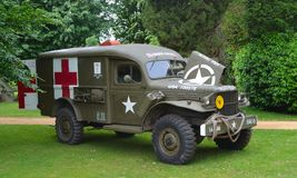 Second World War  Ambulance parked in front of trees Royalty Free Stock Images