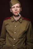 Second world war russian soldier smoking cigarette Stock Images
