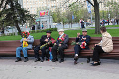 Second World War veterans on bench. Moscow. Stock Images