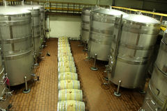 Wine fermentation. The secondary fermentation usually takes place in either large stainless steel vessels with a volume of several cubic meters, or oak barrels royalty free stock photo
