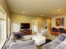 Secondary living room with carpet and bar with stools. Royalty Free Stock Image
