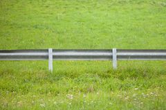 Secondary road guardrail in a mountain pasture Stock Photography
