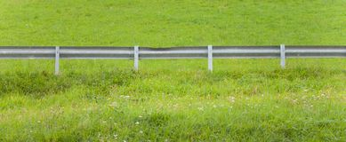 Secondary road guardrail in a mountain pasture Royalty Free Stock Photography