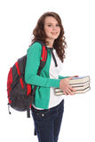 Secondary school happy teenage girl in education. Secondary school teenager girl holding education books, with long brown hair wearing green jumper and red Royalty Free Stock Photos