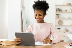 Free Secondary School Student Girl Studying Using Digital Tablet At Home Royalty Free Stock Photos - 194569048