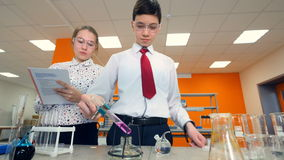 Secondary school students making science experiments. Education concept. stock video