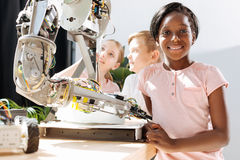 Secondary school students visiting robotics exhibition. Field trip. Close-knit group of pre-teen students visiting robotics exhibition and enjoying themselves Royalty Free Stock Photo