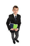 Secondary student carrying text books. High school student in uniform holding text books.  On a white background, shadow under feet Royalty Free Stock Photo