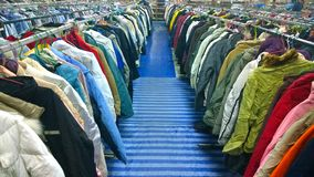 The Secondhand clothes in the market stock photography