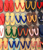 Secondhand sandals. For sale at street market in Thailand Stock Image