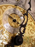 The seconds timer on a grandfather clock. 's gold face Stock Photo