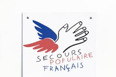 Secours Populaire Francais logo on a wall Royalty Free Stock Images