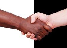 Secousse de deux mains, noire et blanche Image stock