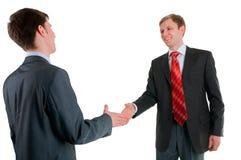 Secousse de main de deux collègues Images stock