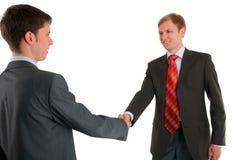 Secousse de main de deux hommes d'affaires Image libre de droits