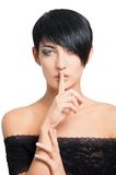 Secrecy. Beautiful lady showing gesture - to keep secret royalty free stock photography