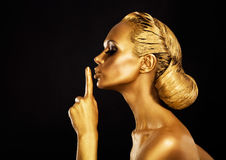 Secrecy. Bodyart. Golden Woman showing Silence Sign. Hush! Royalty Free Stock Image