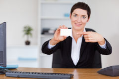 Secrertary showing a blank business card Stock Photos