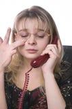 Secretária de grito da menina com um telefone móvel Fotos de Stock