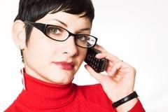 A secretária fala no móbil Imagens de Stock Royalty Free