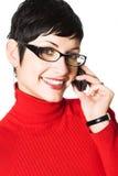 A secretária fala no móbil Fotografia de Stock