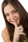 Secret. Secrecy: young woman with a finger over her mouth Stock Photo