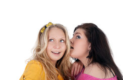 Secret. Pretty young girl whispering something to her friend Stock Photo