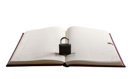 Secret. Notebook with padlock on it isolated on white stock images