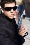 Secret agent. Alertness secret agent ready for action over urban background stock image