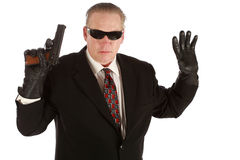Secret agent. Hands up with 9mm isolated on white Royalty Free Stock Image