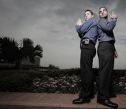 Secret agent businessmen. Two businessmen pretending to be secret agents Stock Photo