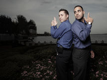 Secret agent businessmen. Two businessmen pretending to be secret agents Stock Photography