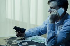 Secret agent and conspiracy theory. Photo of armed secret agent and conspiracy theory Stock Photo