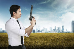 Secret Agent Holding Gun. Ready to fire Stock Photo