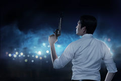 Secret Agent Holding Gun. Ready to fire Royalty Free Stock Photography