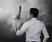 Secret Agent Holding Gun. Ready to fire Royalty Free Stock Photo