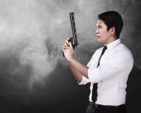 Secret Agent Holding Gun. Ready to fire Stock Photos