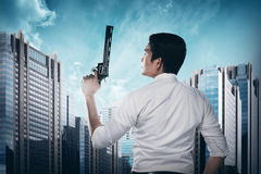 Secret Agent Holding Gun. Ready to fire Stock Images