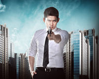 Secret Agent Holding Gun. Ready to fire Royalty Free Stock Photos