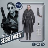 The secret agent lifelike doll. Female secret agent lifelike doll with toy see through packaging, accessories and character holding a gun royalty free stock photography