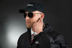 Secret Agent Listening To Earpiece Royalty Free Stock Photo